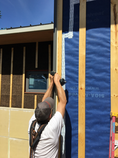 Exterior cork insulation and rainscreen
