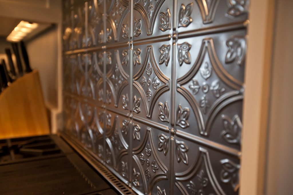 Stamped tin backsplash details in a kitchen remodel