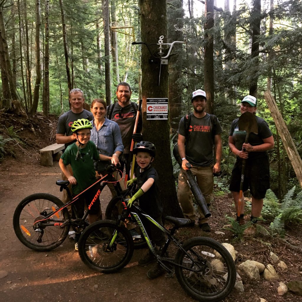 Chuckanut Builders crew at Galbraith Mountain, with tools and bikes.