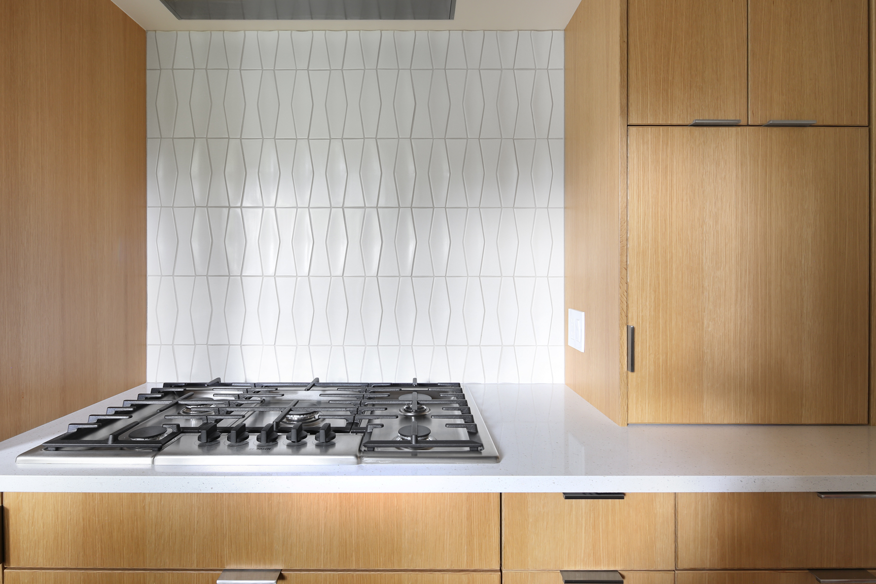 Backsplace, gas range and cabinets by Smith and Vallee
